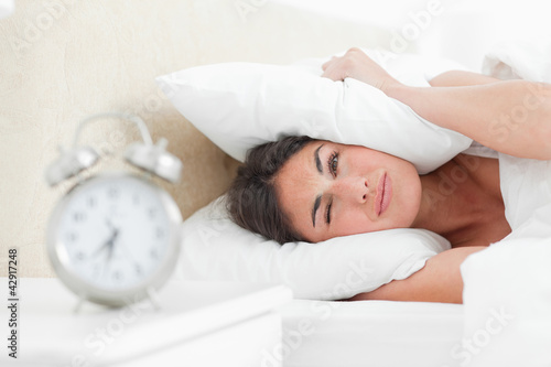Rude awakening for a brunette with her alarm clock