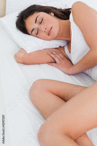 Close-up of a brunette sleeping