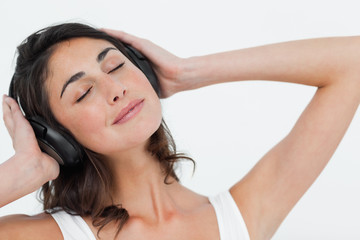 Close-up of a brunette listening to music