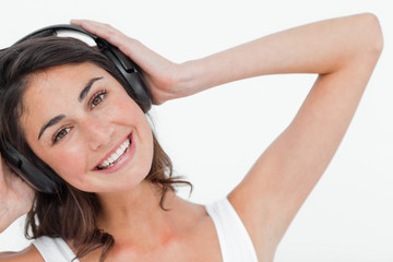 Portrait of a brunette listening to music