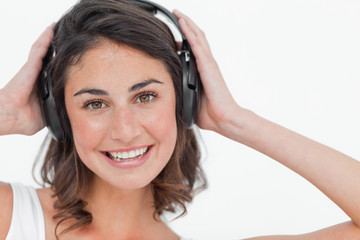 Close-up of a cute brunette listening to music