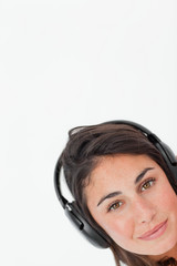 Close-up of a brunette wearing headphones