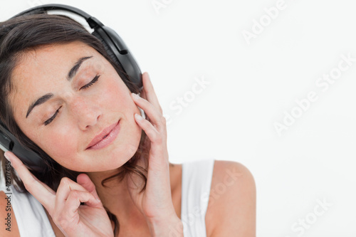 Close-up of a brunette enjoying music