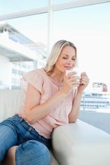 Blonde smelling her herbal tea