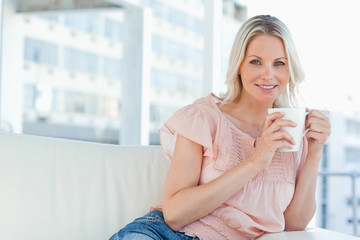 Portrait of a blonde with a cappuccino