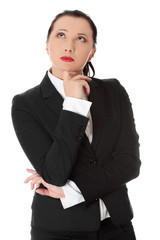 Thinking businesswoman wears black suit.