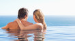 Back view of couple spending time in the pool