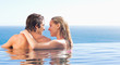 Back view of couple in the pool