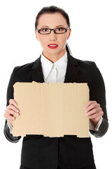 Businesswoman is showing paper cardboard