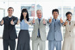 Business people showing their approval by putting their thumbs up