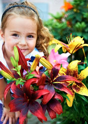 canvas print picture Kind mit den Blumen