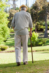 Old man with walking stick in park