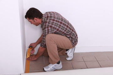 Man taping floor