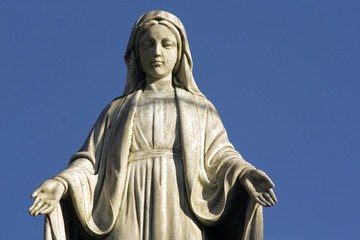 Statue of Virgine Mary looking down with open hands