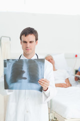 Doctor observing an x-ray scan in front of him
