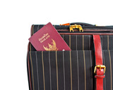 suitcase and thai passport isolated on a white background