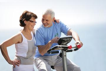 Senior couple with an exercise bike