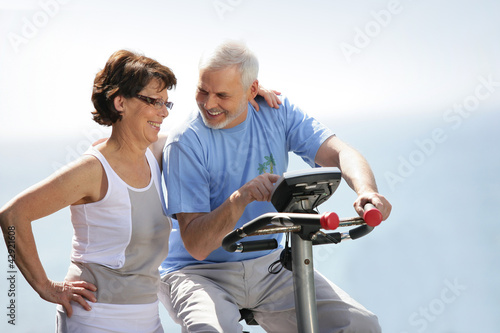 Senior couple with an exercise bike