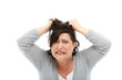 Woman looking stressed, pulling her hair out.
