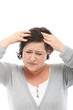 Woman with severe migraine massaging her head