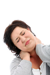 Woman stretching her head to one side to alleviate