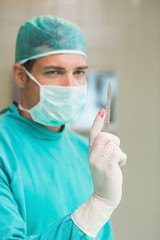 Surgeon holding a surgical scalpel