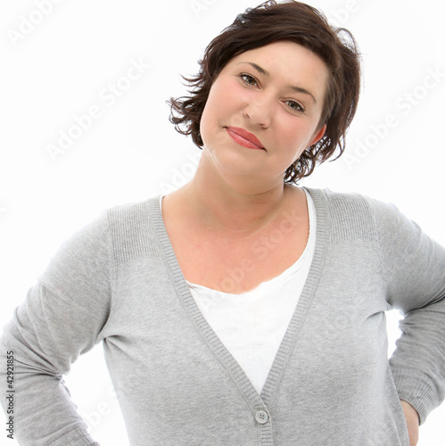Self-assured middle-aged woman at peace with herself