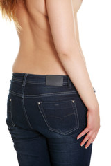 Naked back and waist of young woman with jeans.