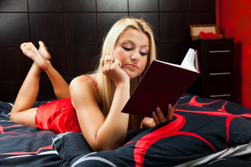 Sexy lady reading in bed