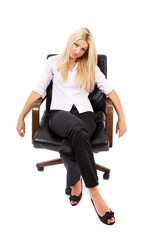 Businesswoman sitting in a chair