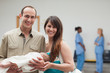 Smiling couple holding a new born baby