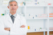 Pharmacist with his arms folded standing in a pharmacy