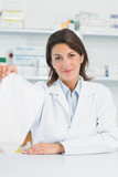 Pharmacist woman holding a prescription