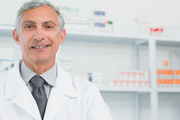 Portrait of a smiling surgeon in a pharmacy