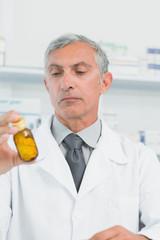 Pharmacist holding a bottle full of pills