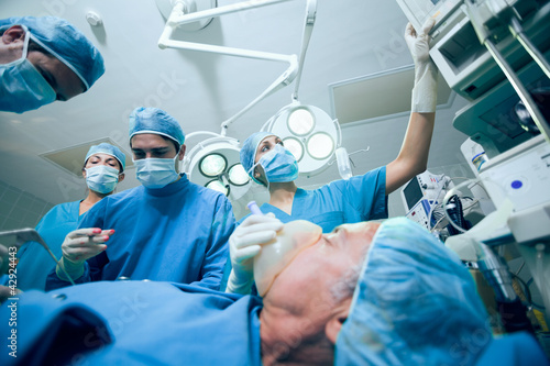Surgical team in an operating theater operating a patient