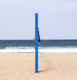 Fototapeta volleyball post at the beach in blue