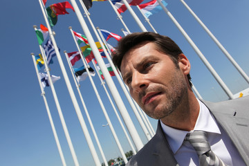 Businessman with flags.