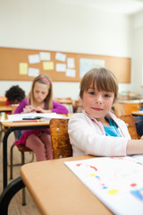 Girl at desk with drawing book