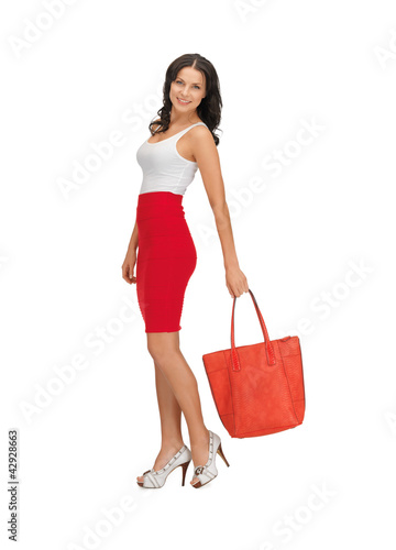 woman in dress with a bag