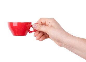 Red porcelain cup with coffee in hand
