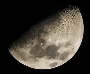 Moon through a telescope showing craters and seas