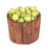 Green gooseberry in wooden cup isolated on white