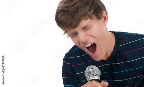 Teenager singing into a microphone