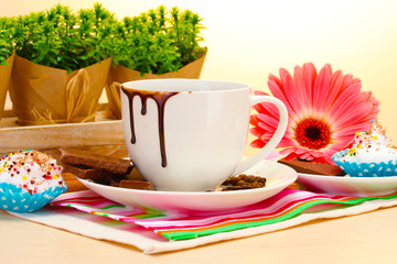 dirty cup of coffee and gerbera  beans, cinnamon sticks