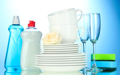empty clean plates, glasses and cups with dishwashing liquid