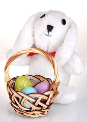White bunny with basket isolated on white