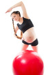 A pregnant young woman  doing exercise on fitball