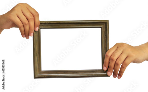 Picture frame in woman hand isolated on white background
