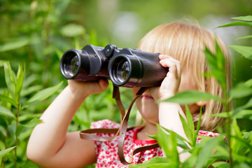 Little girl with binocular